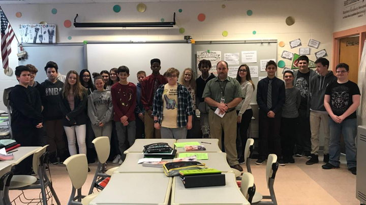 Mr. Carcraft pictured with a group of middle school students.
