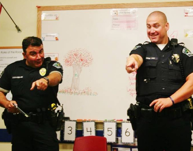 Two police officers visit the Primrose school of Shady Hollow