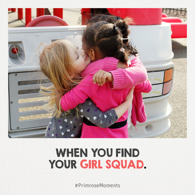 Three young girls hug each other tightly