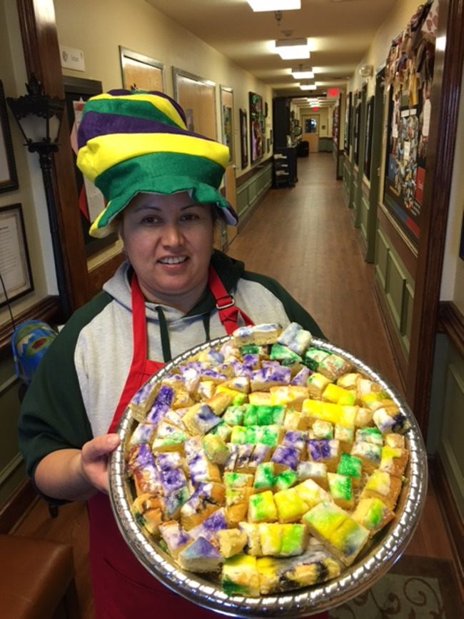 Ms. Juanita with a plate of bite sized king cake pieces