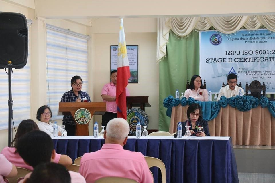 TUV Rheinland Lead Auditor, Ms. Jogina Mendiola explaining important matters during the Opening Program held at HRM Function Hall, LSPU-Santa Cruz Campus.