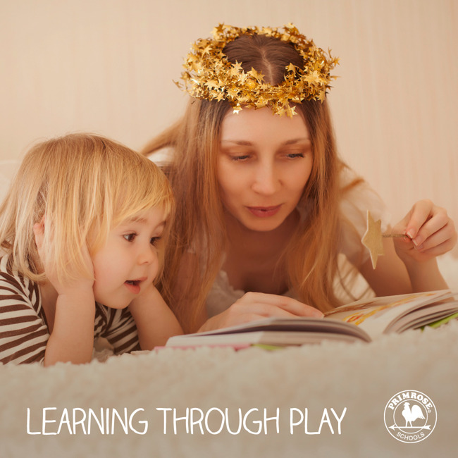 Mother wearing a halo and holding a wand reads a story to her young child