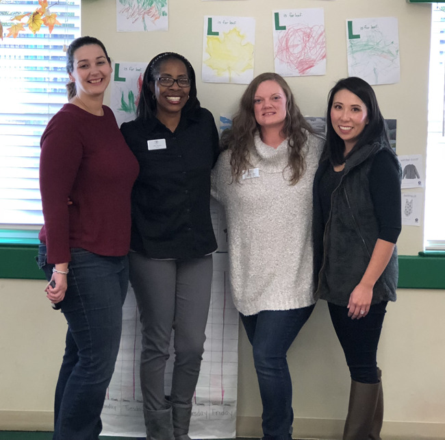 Mrs. Venice Gordon poses with her colleagues in her classroom