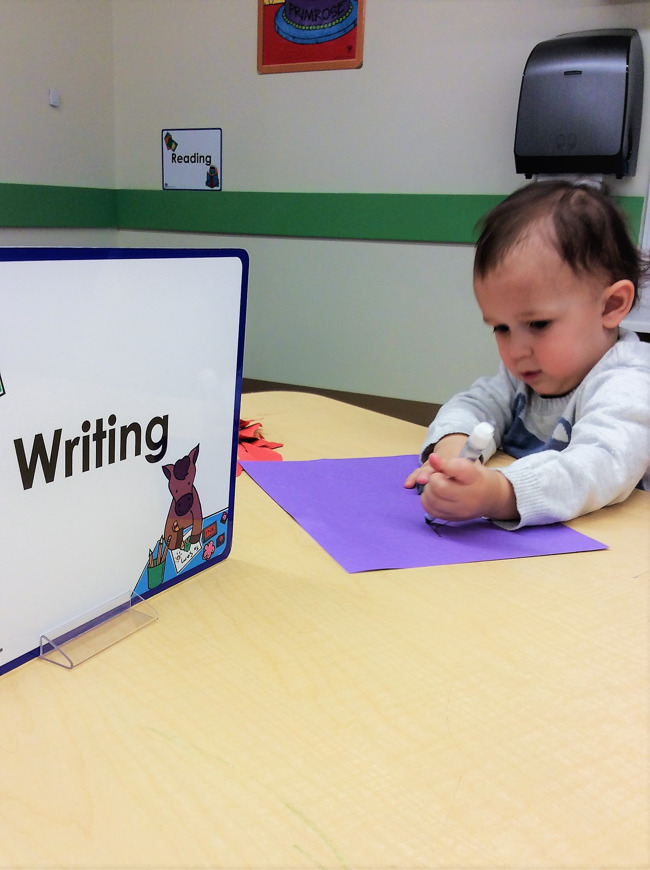 The children have the choice to work in teacher directed center such as this writing center.