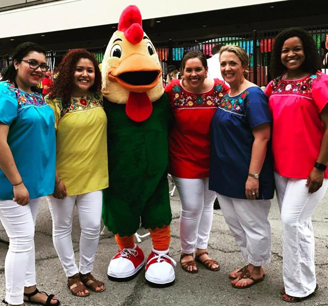 Primrose school of Preston Hollow teachers pose with Percy the chicken mascot