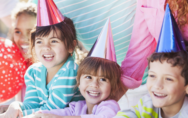 image of children smiling at a birthday party
