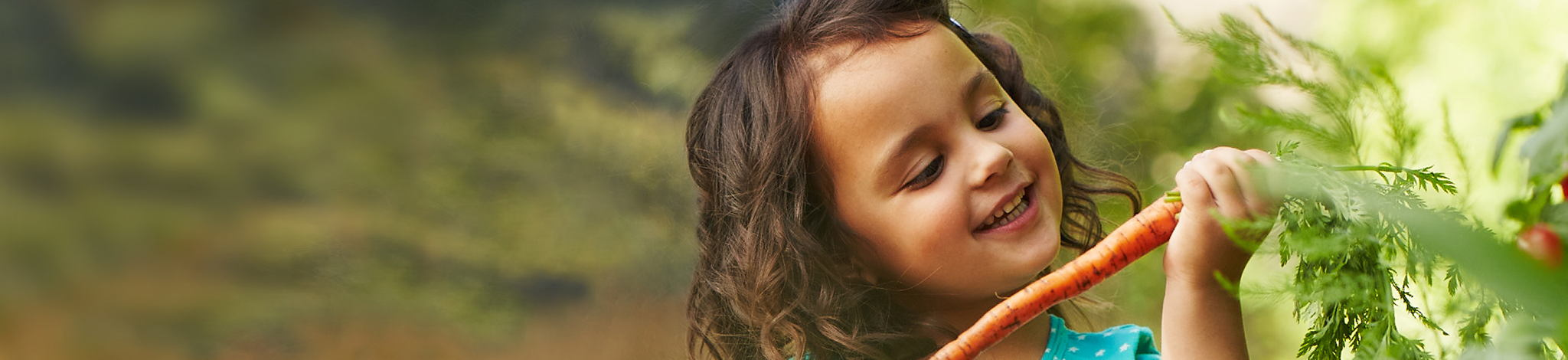 Young Toddler holding carrot
