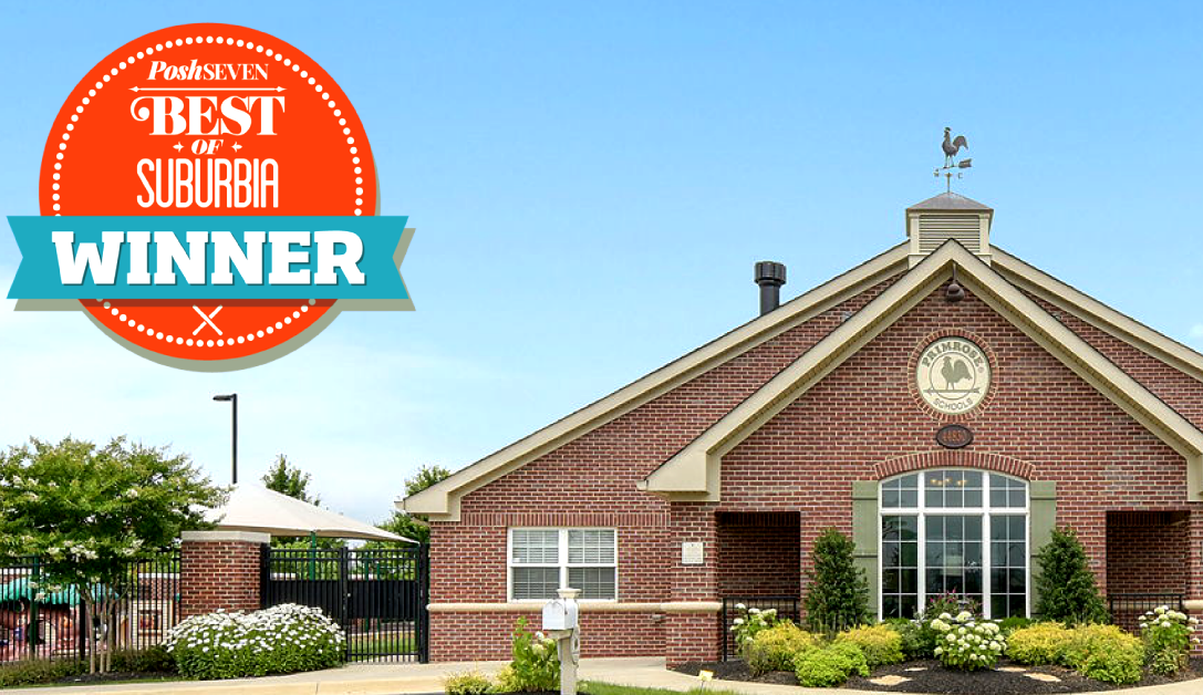 Exterior of the Primrose school of Ashburn with a winner's ribbon for the best preschool in the DC suburbs