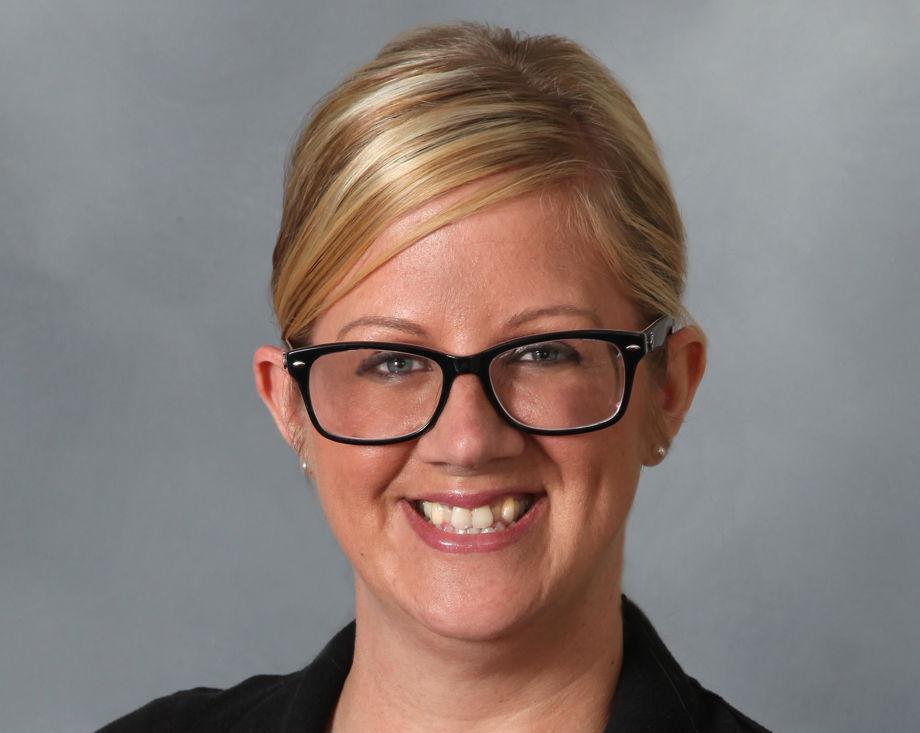 Mrs. Hansen , Assistant Director
