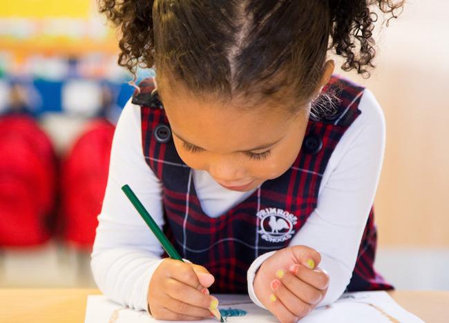 girl in Primrose uniform coloring