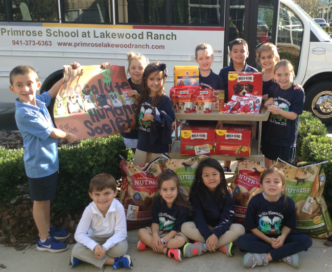 Photo of Explorers Students posing with donated items