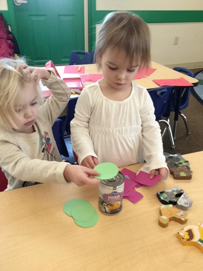 2 year olds working on shapes at Primrose School daycare
