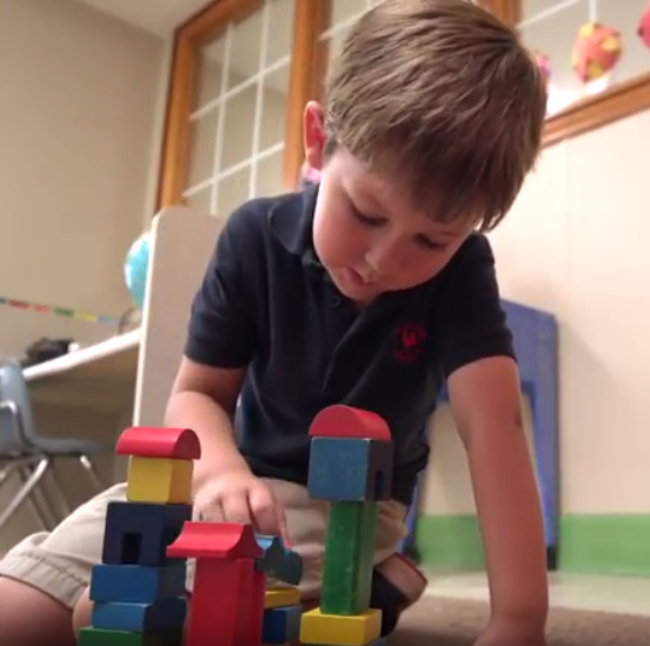Child playing with stacking blocks